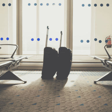 traveling luggage in airport terminal suitcases in P5FMCU4 1