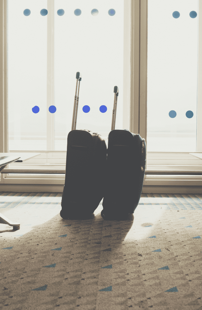 traveling luggage in airport terminal suitcases in P5FMCU4
