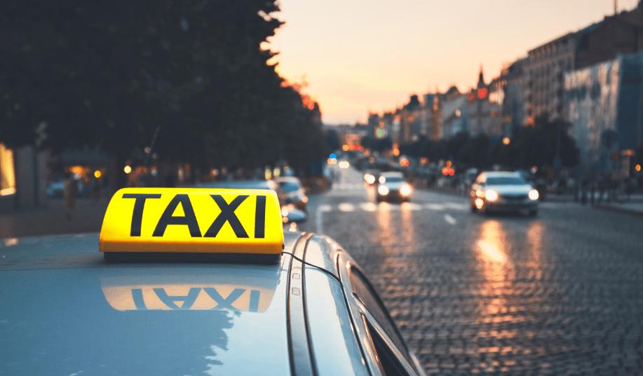 Taxi car on the city street 1